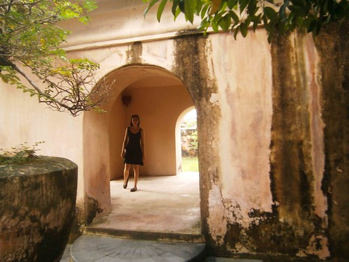 Briana in a Garden building