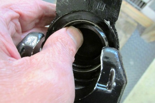 Inserting Piston Seal Into Groove in Caliper Bore