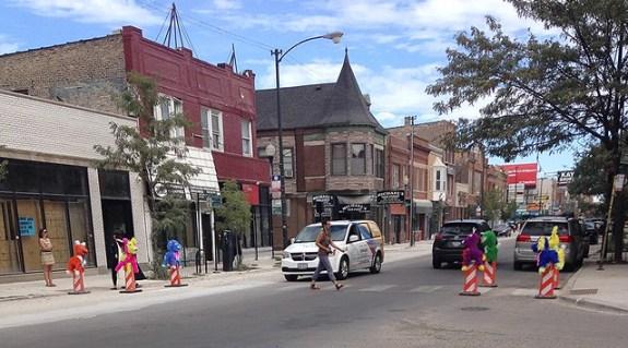 04 Susan Krueger-Barber Pinatas in place in crosswalk at Drake and Milwaukee as traffic calmers 080716