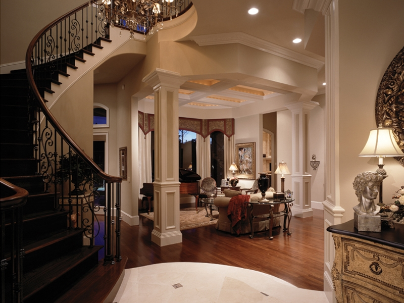 Traditional House Plan Living Room Photo 01 Miranda Place Luxury | Round Staircase House Plans | Beautiful | Small House | Exterior | Dimension | Stair Outside