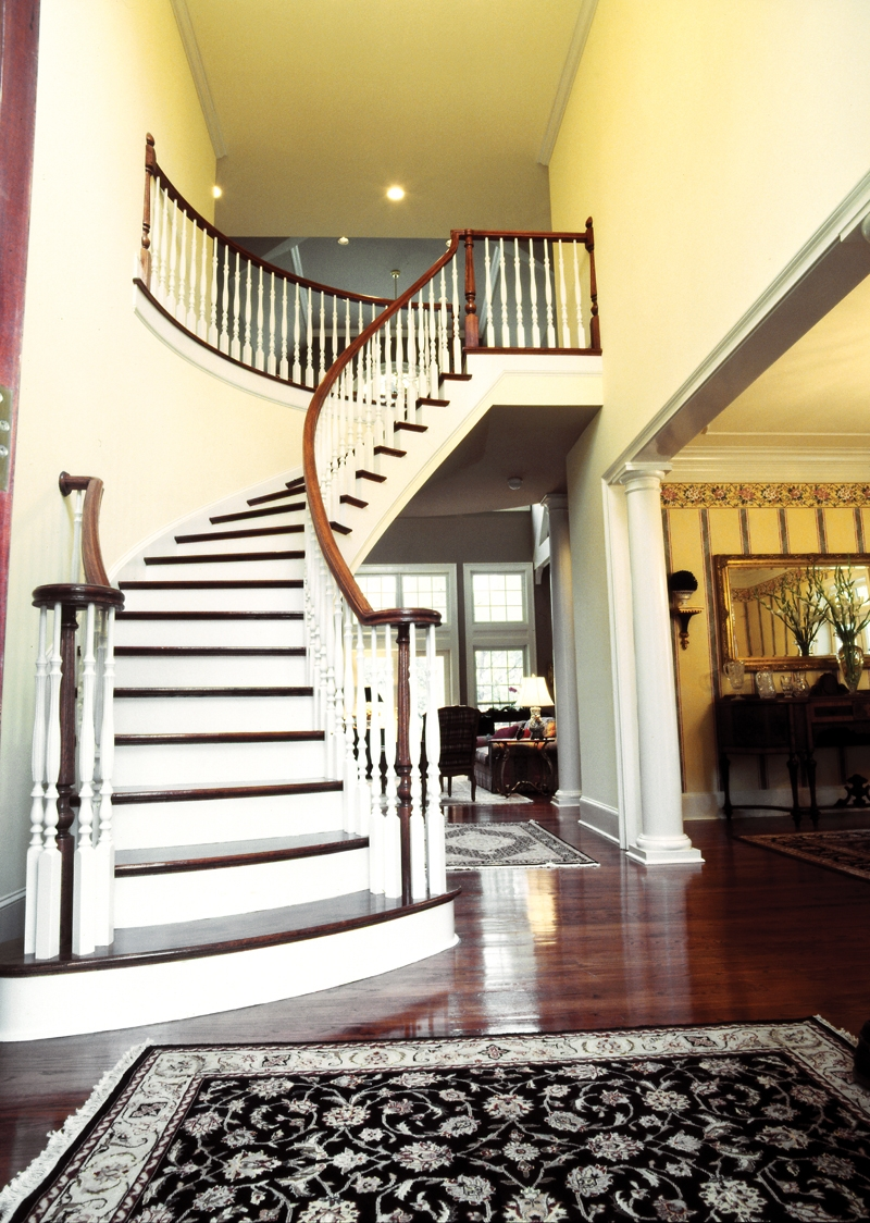 Farmhouse Plan Stairs Photo 02 Avanti Acadian Country Home Plan | House Plans With Stairs In Kitchen | Upstairs | Country Kitchen | Hidden Pantry | Luxury | Small House