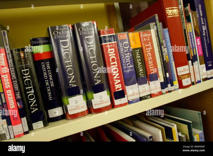 Dictionaries on College library bookshelf Stock Photo ...