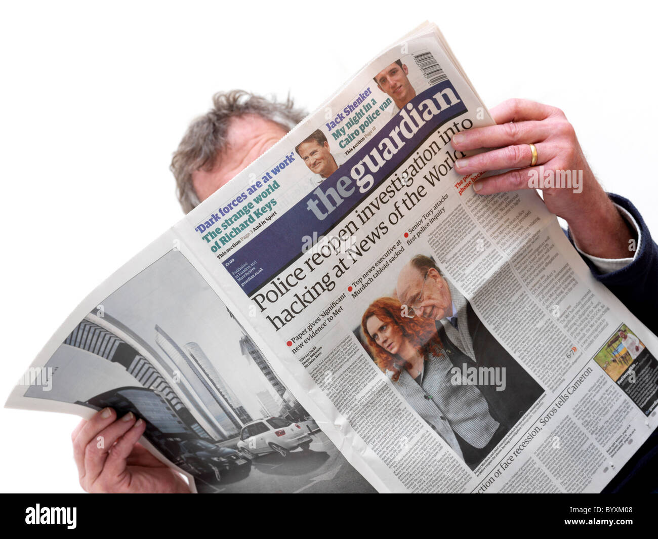 Man Reading The Guardian Newspaper Stock Photo Royalty