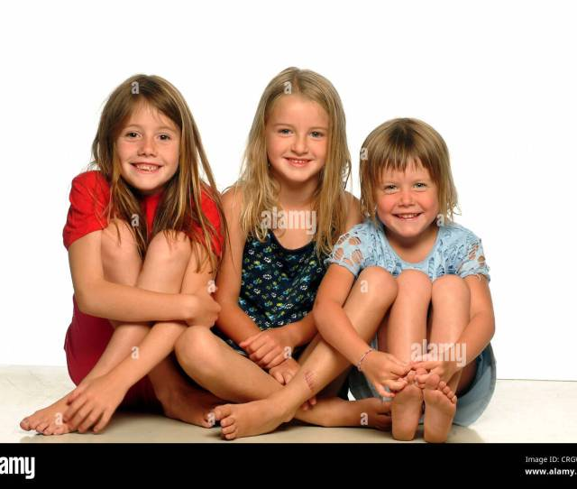 Three Little Girls Sitting Side By Side Barefoot