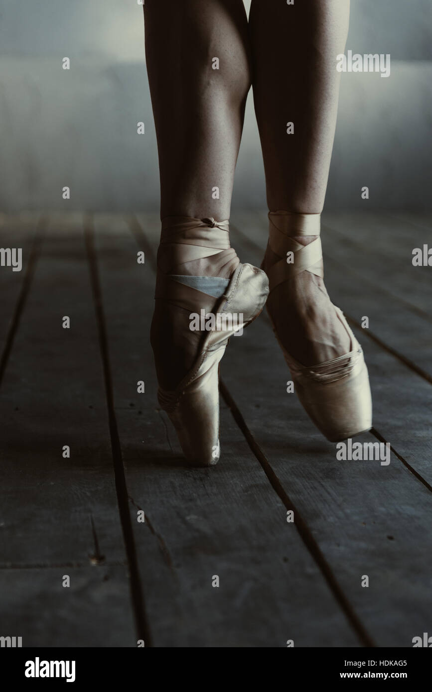Ballet dancer standing on the tiptoes in the black room Stock Photo     Ballet dancer standing on the tiptoes in the black room