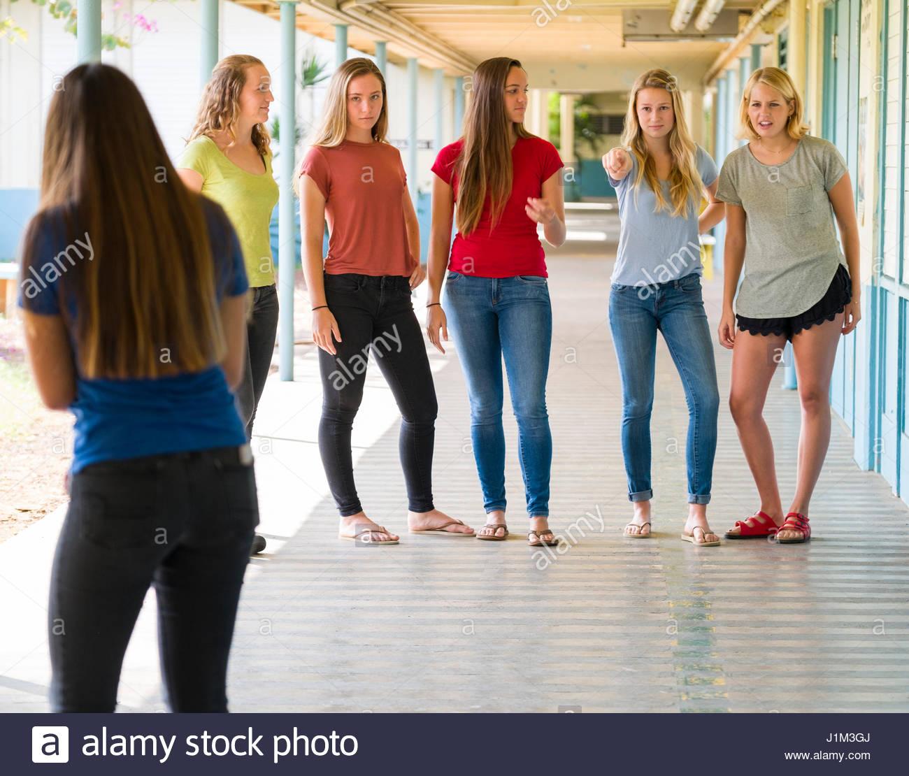 Group Of Teenage Girls Bullying Teen Girl At High School