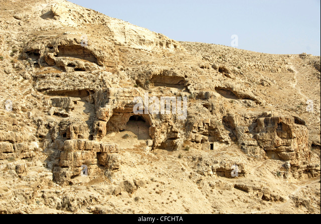 Ascetic monk caves at the Monastery of Mar-Saba (St Savva), Judean Desert, Israel - Stock Image