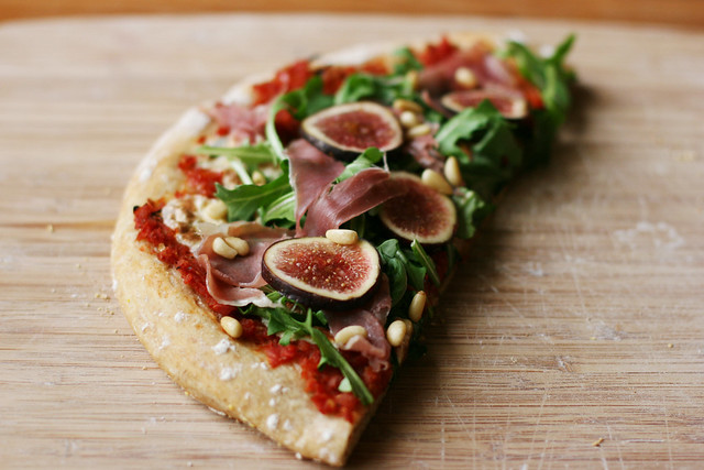 Prosciutto (fig) pizza with arugula and pine nuts