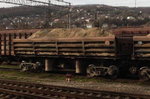 Russian Railways side dump wagons loaded with sand
