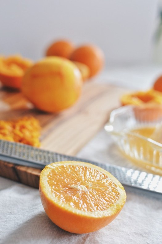 Sliced oranges to be juiced for sauce.