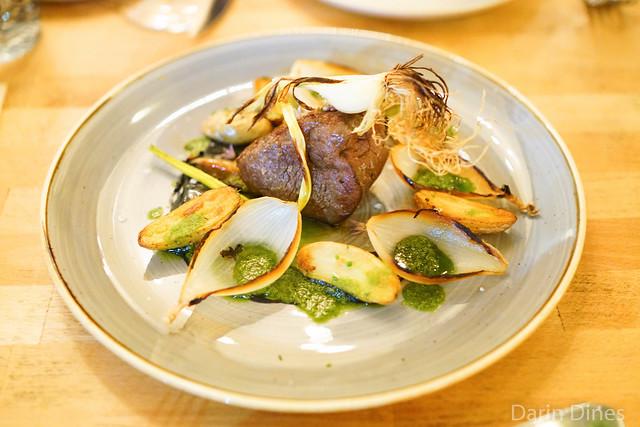 BEEF TENDERLOIN burnt onions / fingerling potato / bitter herb oil