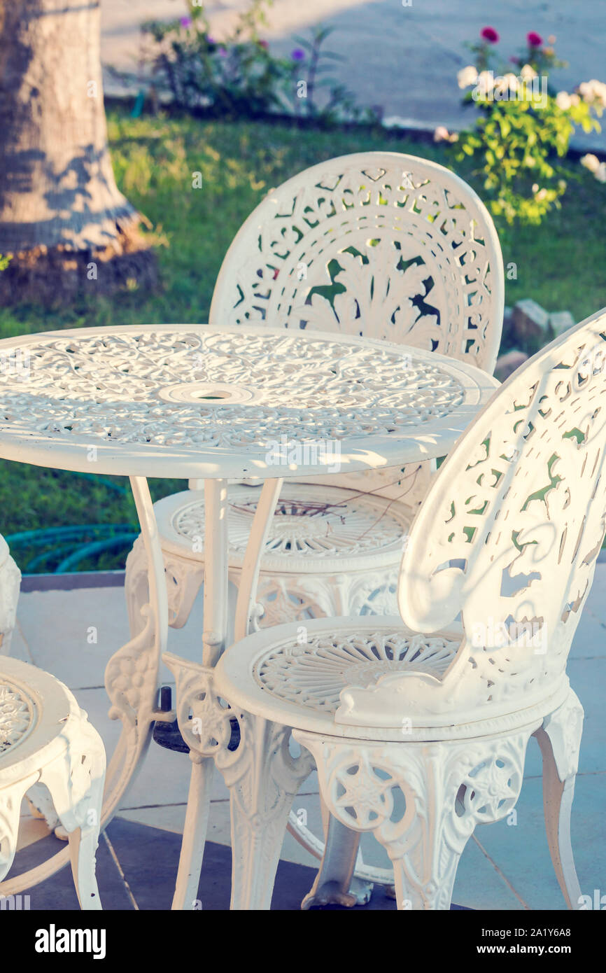 https www alamy com vintage wrought iron garden table and chairs in a garden image328209344 html
