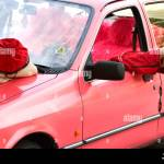 Russ Sixth Formers Cap Worn By Russ Inside Outside Pink Car The Feet Sticking Out Of The Window Stock Photo Alamy