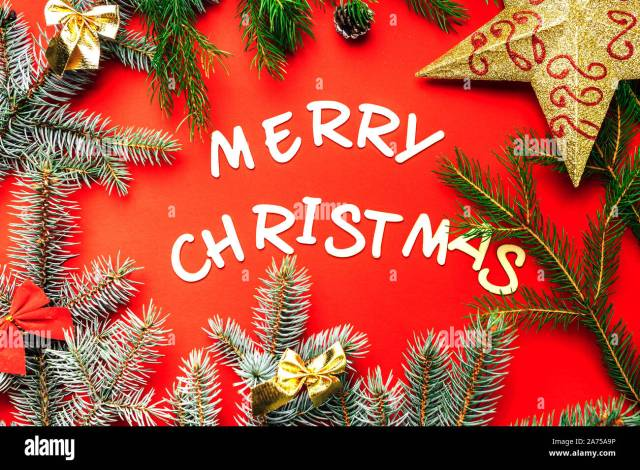 Wooden letters of Merry Christmas words on red background flat lay