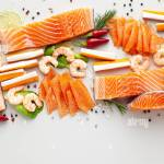 Fresh Seafood On A Table With Spices Vegetables And Olive Oil Fresh And Smoked Salmon Shrimp And Crab Sticks For A Supermarket Or Fish Sushi Restau Stock Photo Alamy