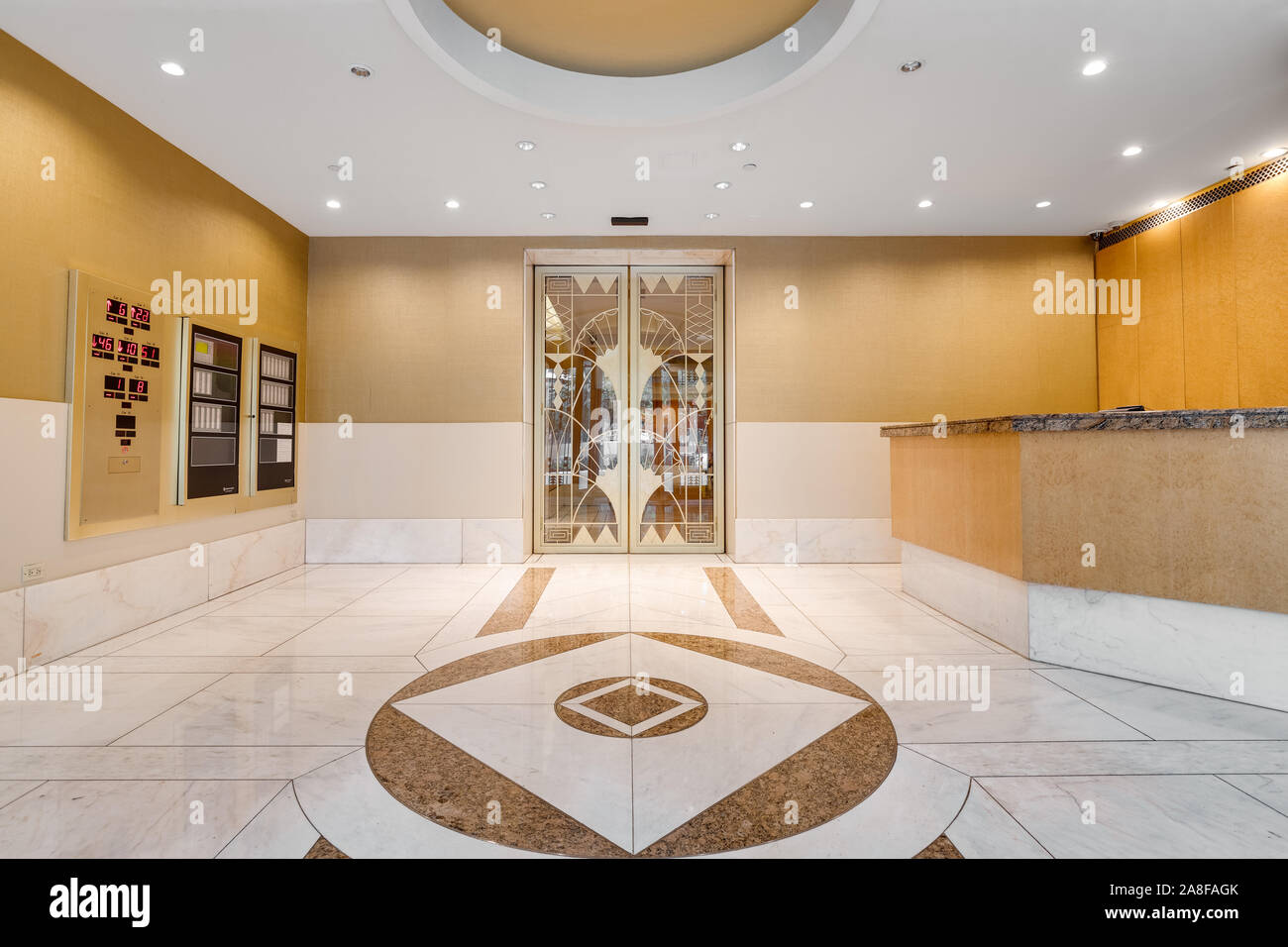 https www alamy com front lobby area of a downtown chicago high rise with yellow walls marble tile and a fancy gold door leading to the elevators image332251827 html