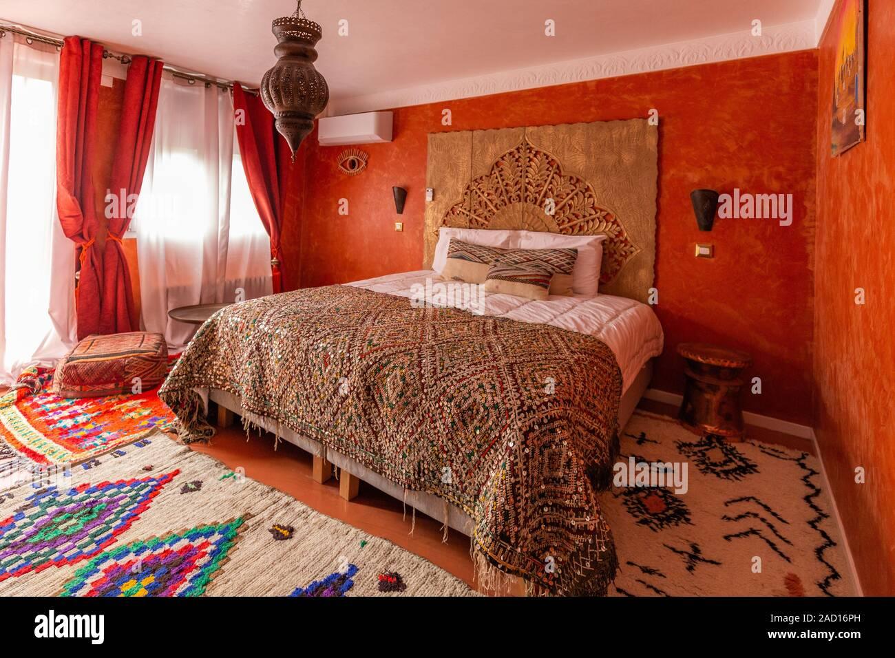 Beautiful Design Of An Oriental Interior Of A Bedroom With Kingsize Bed Wooden Bedboard And Furniture Stock Photo Alamy