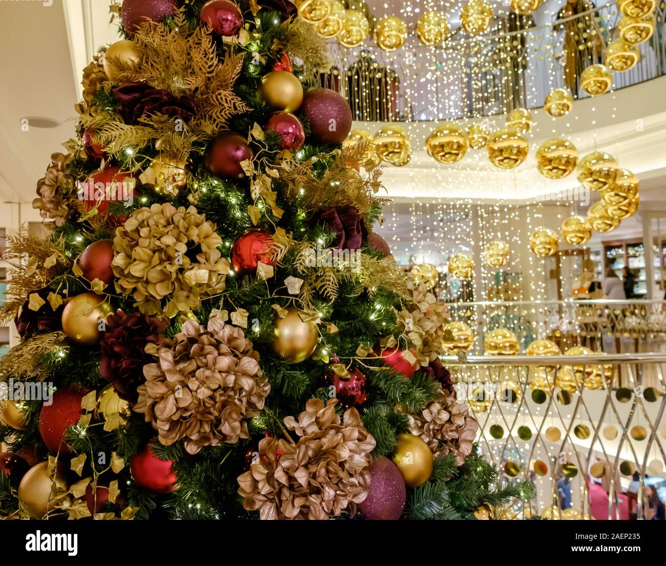 Central London Decorated Christmas Tree Next To Stair Well With Hanging Gold Baubles In Spiral Shape At High End Department Store Fortnum Mason Uk Stock Photo Alamy