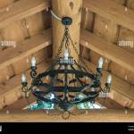 Round Black Wrought Iron Chandelier With Bulbs Weighs In The Summer House Stock Photo Alamy