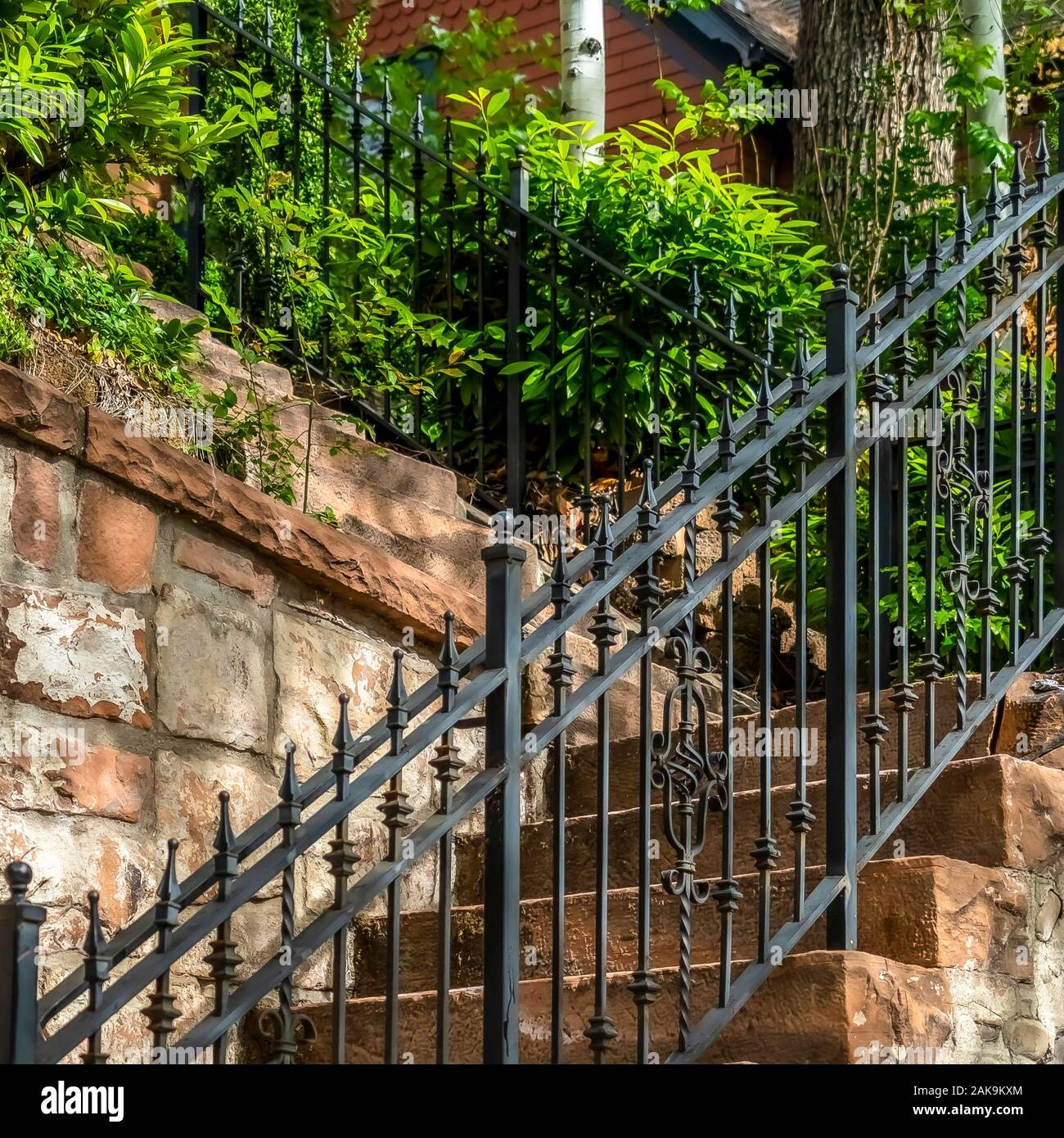 Square Frame Outdoor Staircase With Stone Steps And Black Metal | Black Outdoor Stair Railing | Interior Stair | Modern | Pipe | Composite Deck | 2 Step