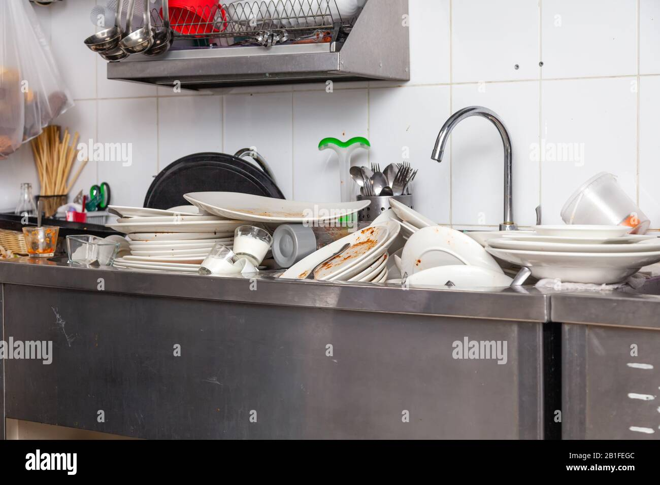 https www alamy com large metal sink with dirty dishes in professional restaurant kitchen stack of unclean white plates crockery appliances with leftover food water t image345162732 html