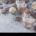 Coffee Mocha Milkshake With Cookies And Cream Ice Cream And Chocolate Cookies Sweet Latte Cocktail On Gray Concrete Table With Spoon And Cup Of Van Stock Photo Alamy