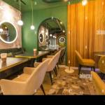 Modern Restaurant Interior With Tables And Sofas Light Green Walls Stock Photo Alamy