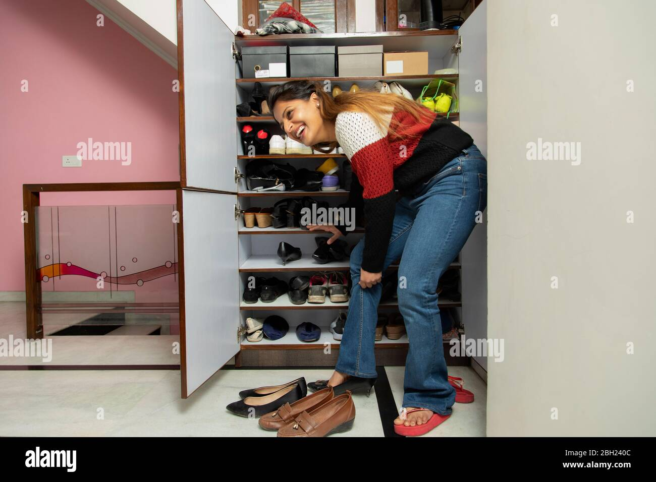 https www alamy com woman trying on heels from the shoe rack at home image354703564 html