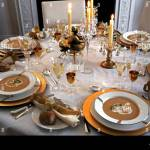 Formal Festive Table Setting For Holiday Or Wedding Celebration With Soup In Large Open Bowls On Gold Edged Plate On Golden Platters With Candles And Stock Photo Alamy