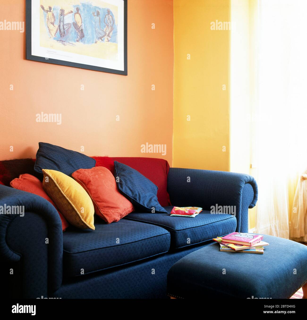 https www alamy com blue upholstered stool and matching sofa with colourful cushions image359248360 html