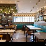 Elegant And Modern Restaurant With Wooden Walls And Ceramic Floors Blackboard On A Restaurant Wall Stock Photo Alamy