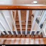 Square U Shaped Staircase With White Baluster Brown Handrail And Carpet On Treads Stock Photo Alamy