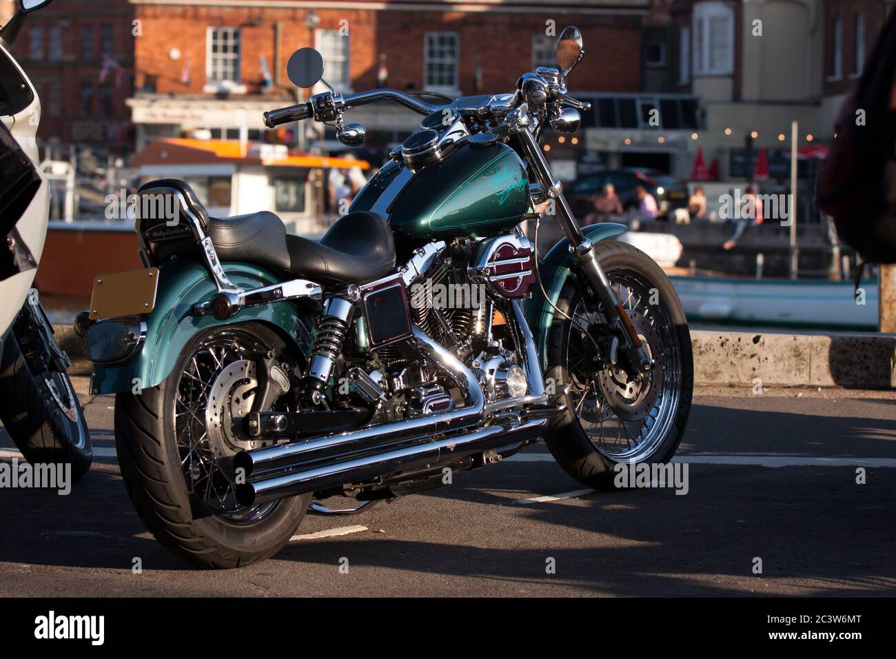 https www alamy com a green harley davidson motorcycle with vance and hines exhaust pipes parked overlooking the harbour on weymouth quayside image363815784 html