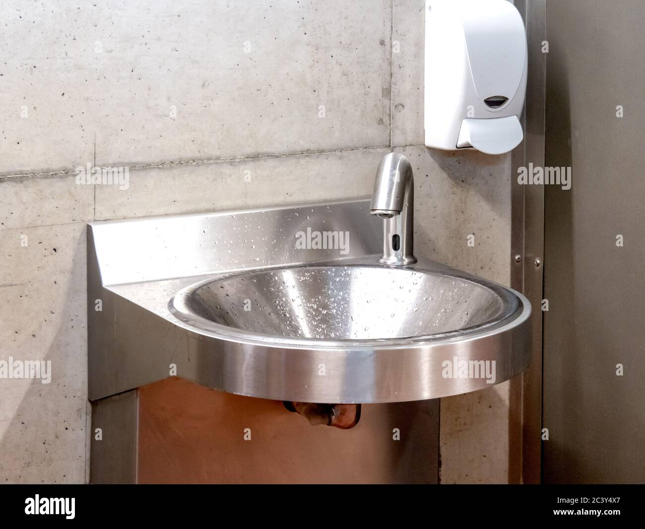 https www alamy com a stainless steel metal hand washing sink with hands free faucet as might be found in a factory or public washroom image363858271 html
