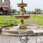 Outdoor Cafe Terrace With Fountain Empty Chairs In Cafe Or Restaurant On Summer Day Restaurant Terrace In Small European City Stock Photo Alamy