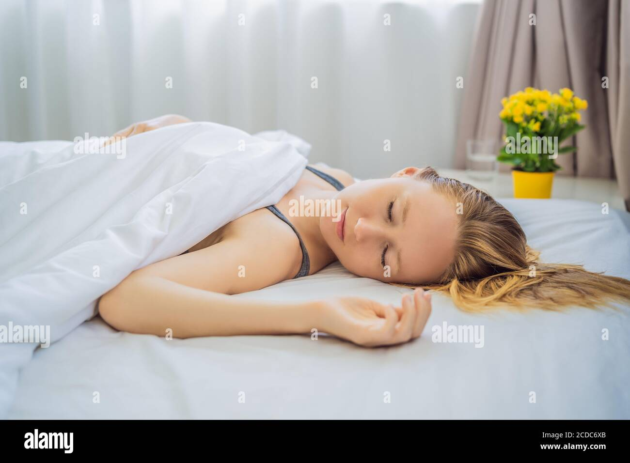 https www alamy com sleep without a pillow young woman sleeping in bed without a pillow portrait of beautiful female resting on comfortable bed without a pillow in image369677123 html