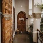 Interior Of Balcony Of Aged Stone House With Columns And Ornamental Wooden Doors In Marrakesh City In Morocco Stock Photo Alamy