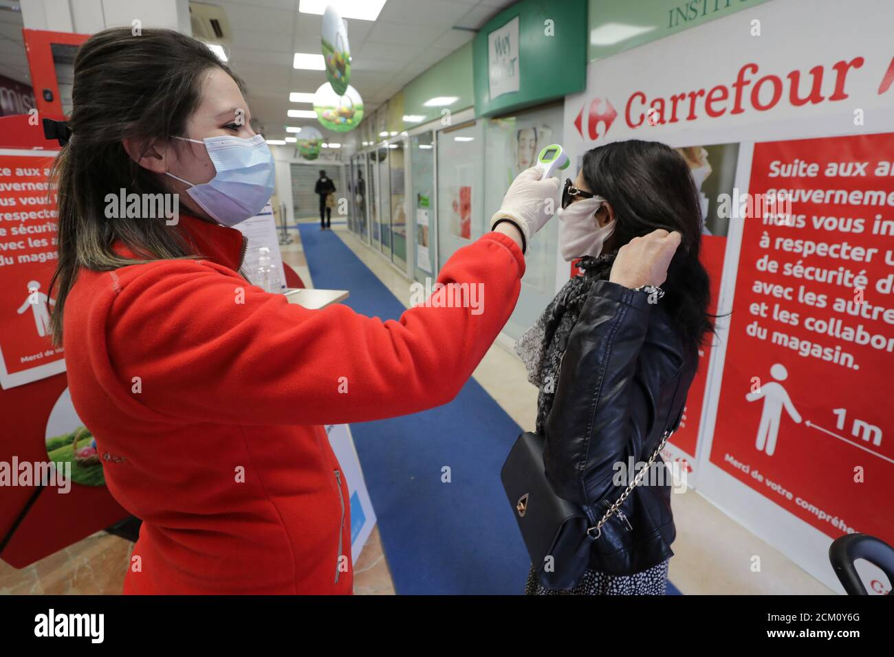 https www alamy com an employee wearing a protective face mask checks the temperature of a customer before she enters inside a carrefour market in cannes as the spread of the coronavirus disease covid 19 continues in france april 8 2020 reuterseric gaillard image373732200 html