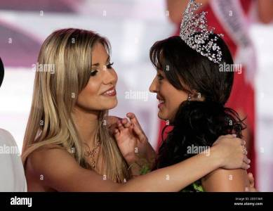Miss France 2006 Alexandra Rosenfeld (L) Congratulates Miss France 2007  Rachel Legrain Trapani After Trapani Won The Competition In Poitiers,  Central France December 9, 2006. Thirty Seven Participants Competed For The  Title.