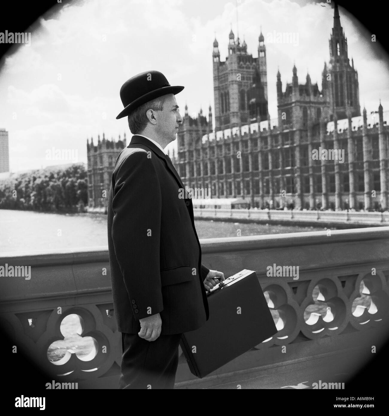 Englishman In Bowler Hat On Westminster Bridge With Houses