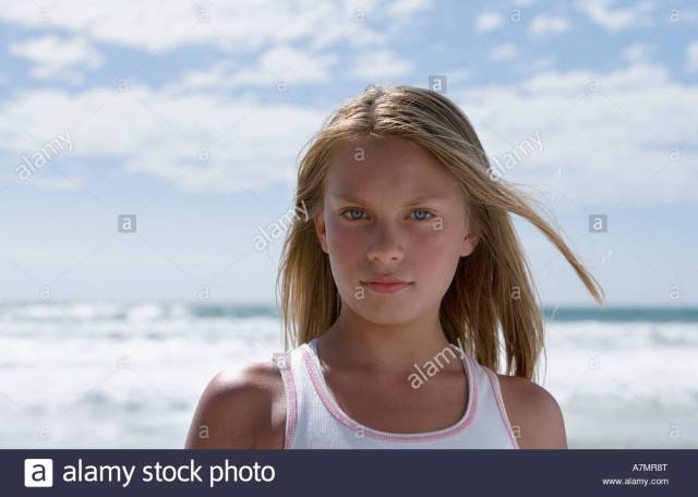 Teenage Girl 13 15 Standing On Beach Front View Portrait