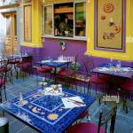 Vividly Coloured Exterior And Tables Of A Small Restaurant On Rue Stock Photo Alamy