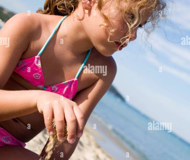 Young Girl Playing By Herself On The Shore Ramatuelle Cote Dazur