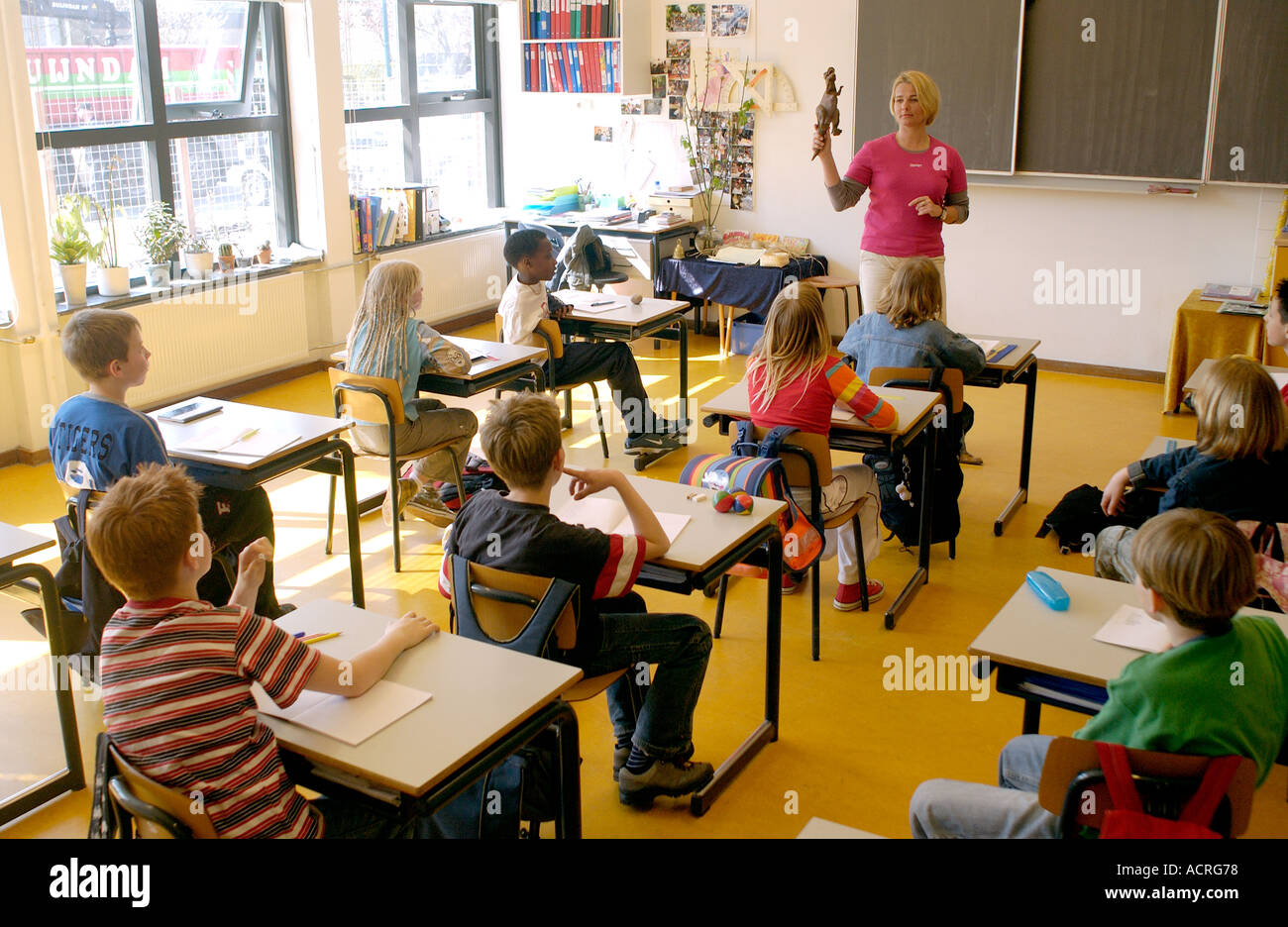 Students In Classroom Of Primary School Stock Photo