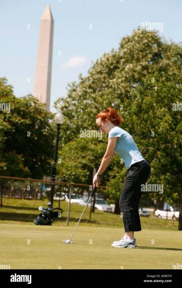 A woman playing golf  East Potomac Golf Course  Washington DC     A woman playing golf  East Potomac Golf Course  Washington DC  United  States  USA