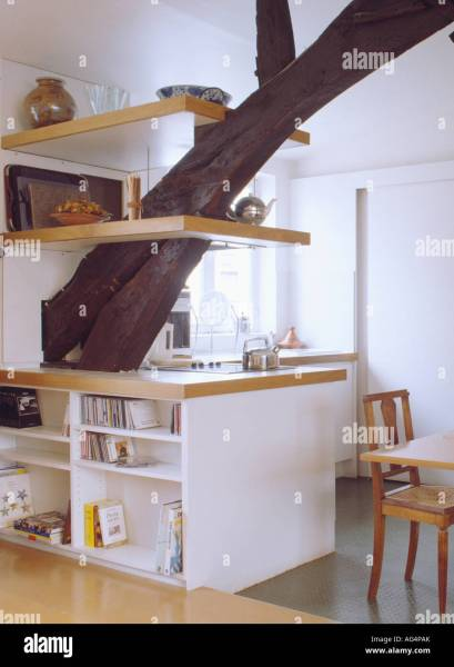 Shelves on large supporting beam in modern white loft kitchen with     Shelves on large supporting beam in modern white loft kitchen with fitted  units