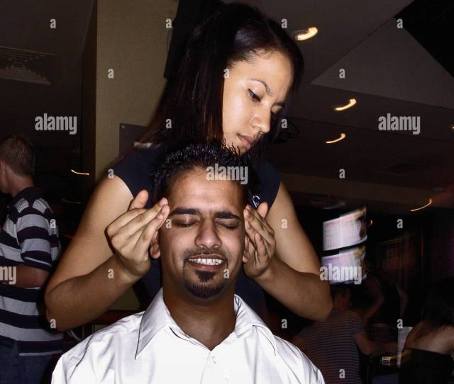 Young Girl Performs Head Massage To A Young Asian Man In A Night Clublondonengland