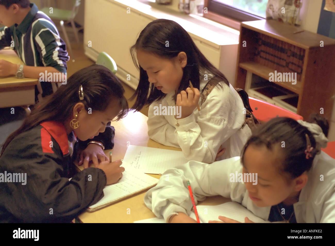 Asian American Sixth Grade Girls Writing In A Summer