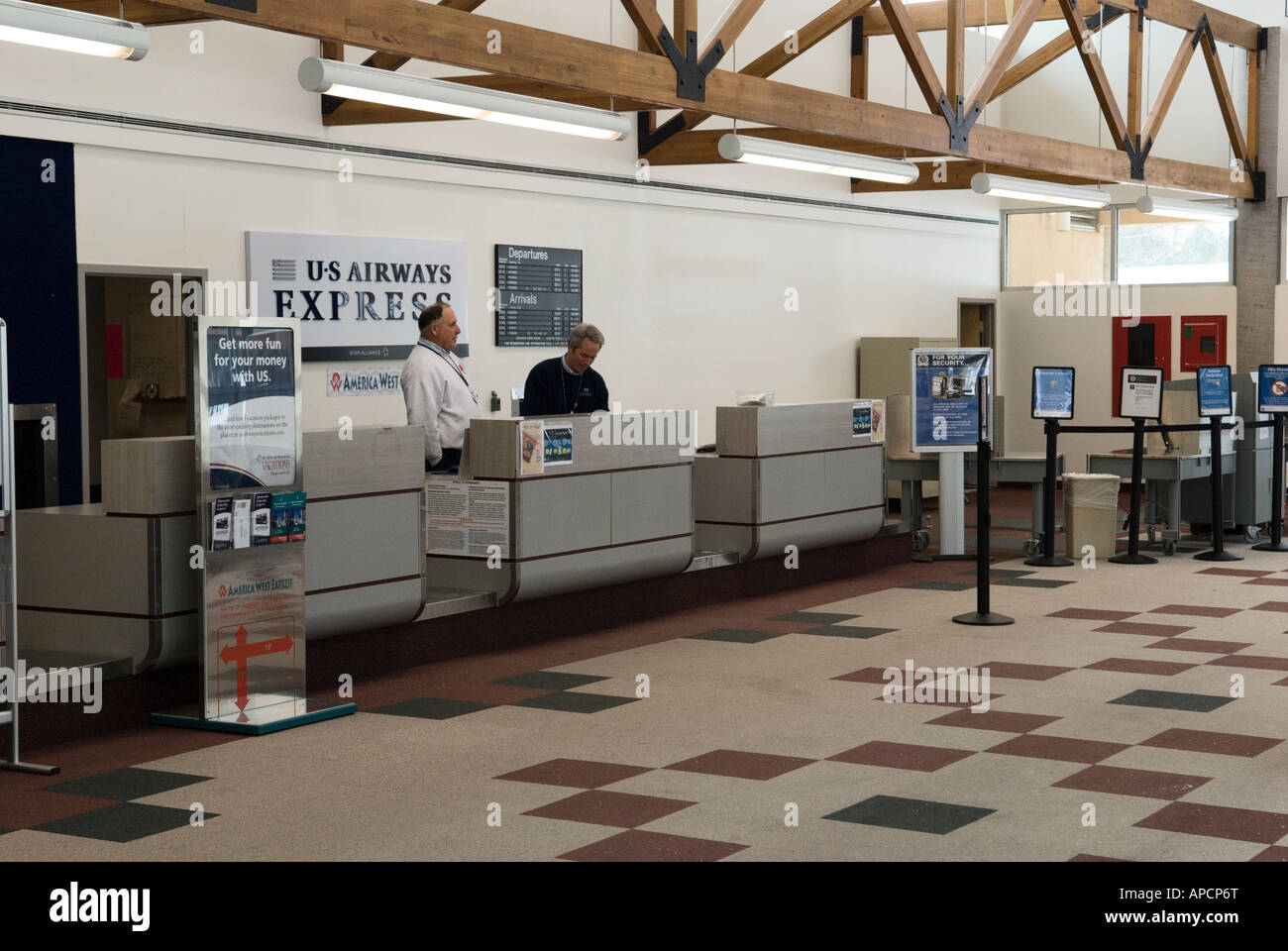 Interior shots of the Flagstaff Arizona airport terminal with     Interior shots of the Flagstaff Arizona airport terminal with airline  employees behind the counter