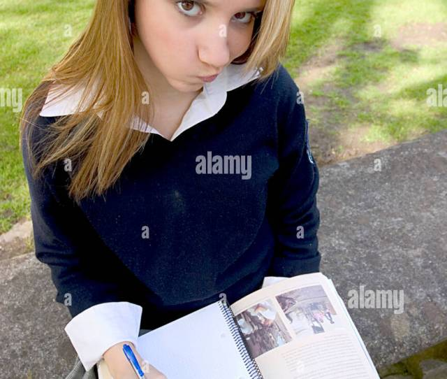 Teenage Blonde Schoolgirl Studying In The Park And Looking Desperate At The Camera